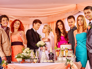 Group people at wedding table.