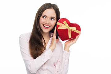 Woman holding heart-shaped box