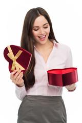 Woman opening heart shaped box