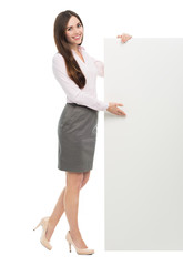 Beautiful woman holding big white poster