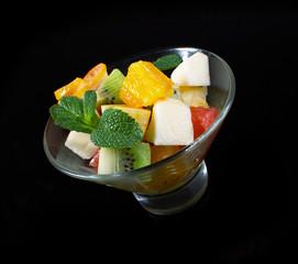 Fruit salad on a black.