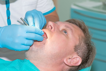 man in dentist office doing annual check up