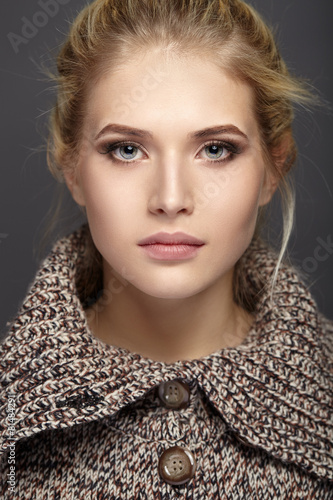 Close-up portrait of beautiful girl in knit sweater - 81484291