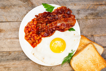 fried eggs with bacon and beans