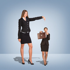 Smiling Young Businesswoman Pointing to small woman with