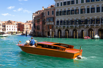 A specific water taxi on The Grand Canal in Venice. The canals s