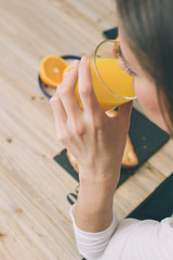 girl drinking delicious orange juice during her breakfast