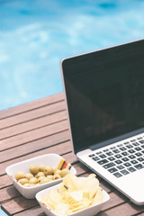 laptop near the pool