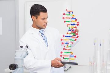 Focus scientist looking at DNA helix