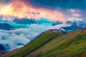 Mountain refuge in the foggy Val di Fassa valley