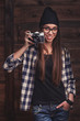 girl in glasses  with vintage camera