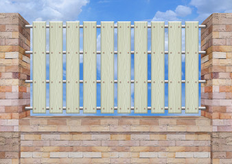 White picket fence, brick wall.