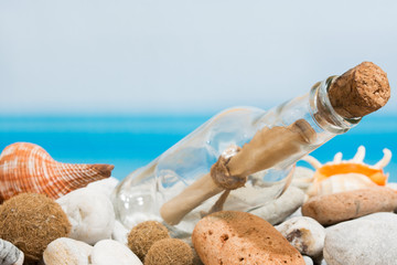 Message in bottle on the beach with stones
