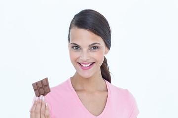 Pretty woman holding chocolate bars