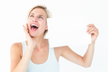 Happy blonde with poster screaming