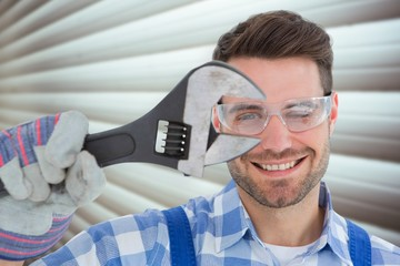 Confident repairman wearing protective glasses