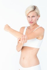 Woman with elbow pain looking at camera