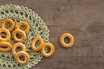 traditional bagels and lace doily on a wooden table