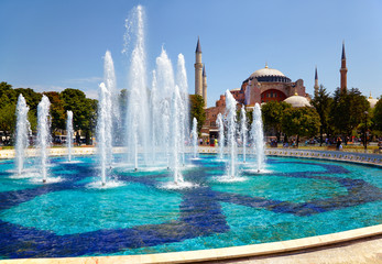 The fontain  in Sultan Ahmet Park with Hagia Sophia in the backg