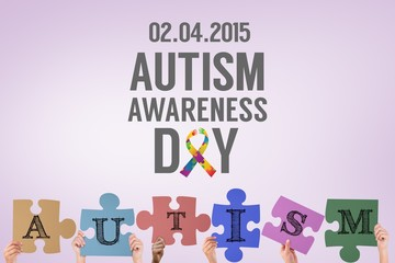 Composite image of hands holding up autism jigsaw pieces