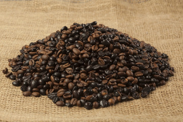 Heap of coffee beans in different roasting grades