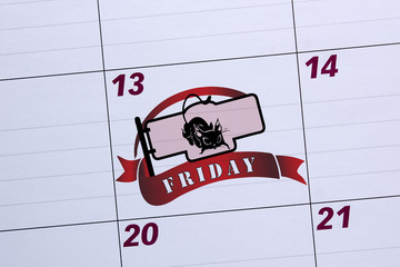 Office calendar marked Friday the 13th