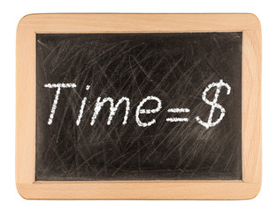 """Time is money"" handwritten with white chalk on a blackboard"