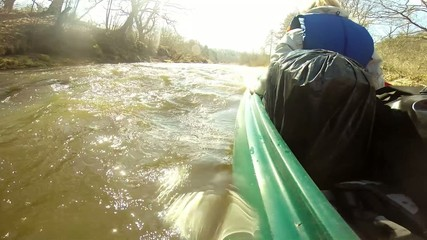 rowing down a wild river