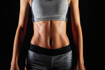 Close up of fit woman's torso with her hands