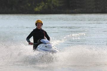 A girl on the jet ski.