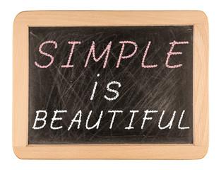 Simple is beautiful words written on blackboard