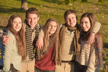 Group of Five Teens Embracing