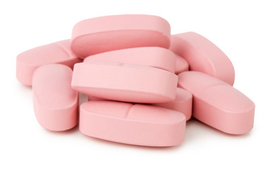 pink pills isolated on a white background