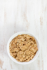 cereals in white bowl on white background