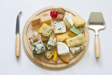 Various types of cheese  on white abstract still life