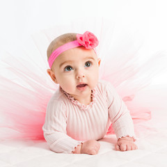 six-month girl in a pink skirt