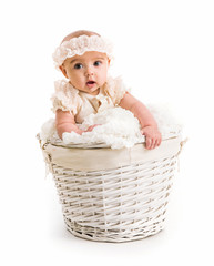 cute little girl in a wicker basket