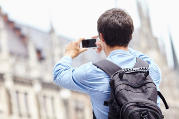 Tourist taking photo with phone
