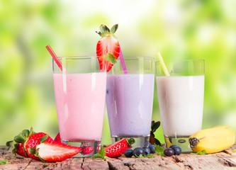 Fresh milk shake on wooden table