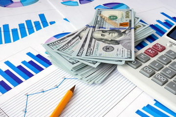 Dollars  on documents. Financial planning concept.