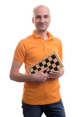 bald man holding a chessboard