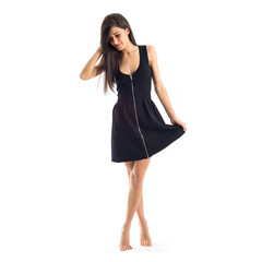 Smiling brunette woman with black dress barefoot isolated on whi