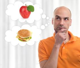 man choosing between apple and sandwich