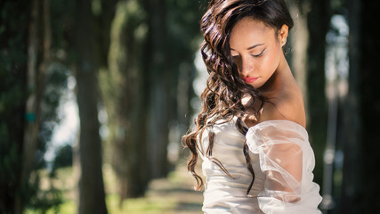 Sensual intimate bride portrait outdoors in a park.