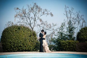 Happy romantic young wedding couple portrait outdoors.