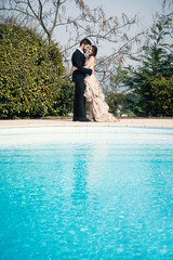Happy romantic young wedding couple portrait outdoors with copy
