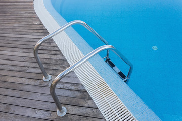 Strengthening stair to enter pool. Railings made of stainless.