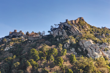 Vintage wall ruins of castle Mouros on hill. Sintra Portugal.