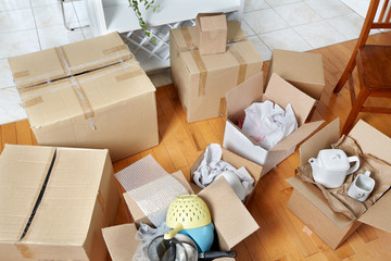Moving boxes in new house.