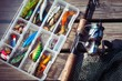 Fishing Lures in tackle boxes with spinning rod and net - 81496808